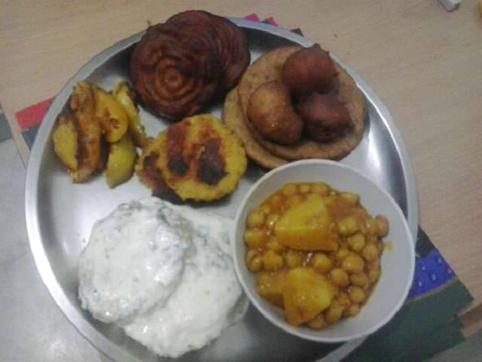 A regular plate with six dishes prepared during Sair festival