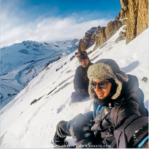 HImanshu and Motu, a Spiti friend resting in a safe area, without  triggering an avalanche in 4 feet of snow