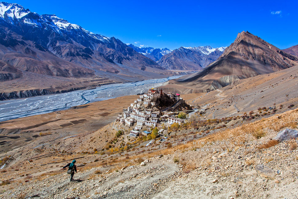 A hiker walks down to Key Monestary in Spiti